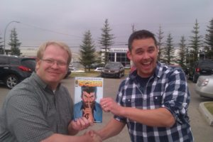Brett of We Talk Podcasts sharing a Copy of Joe's SCAM with Comic Canuck of www.comicbooktherapy.com/